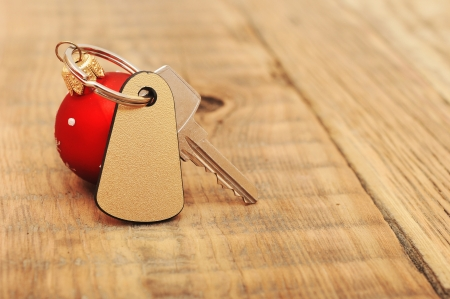 The key with Christmas ball on wooden background photo