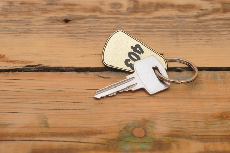 silver key with golden label on wood background photo