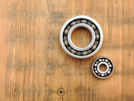 steel ball bearings on wooden background photo