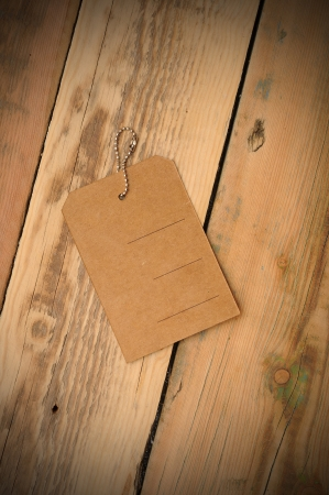the blank price tag label on wooden background photo
