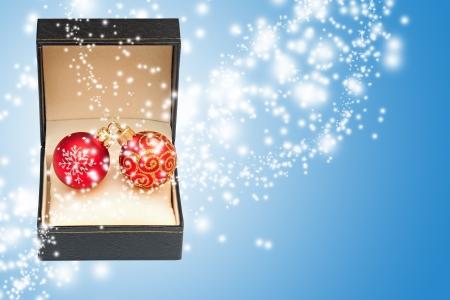 Open magic gift box on blue background  Stock Photo