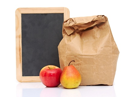 apple paper bag: School lunch with fruit and black chalkboard ready for your text.