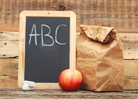 apple paper bag: School lunch with  black chalkboard ready for your text.