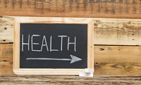 'health' word on blackboard with arrow  photo