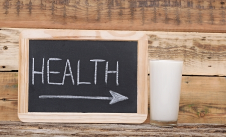health word on blackboard with arrow show on glass milk photo