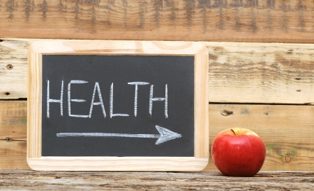 health word on blackboard with arrow show on red apple photo