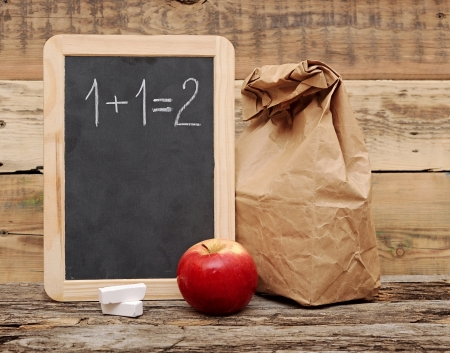 school lunch over blank blackboard photo