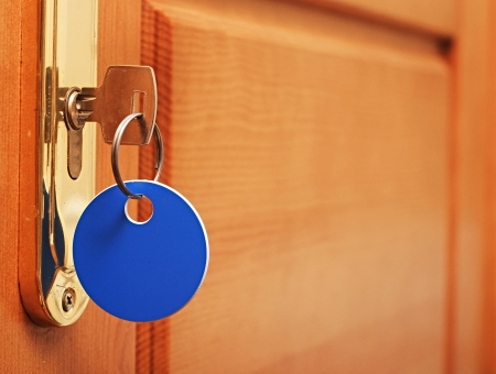 key in keyhole with blank tag Stock Photo - 16386293