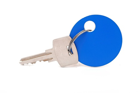 Key with blank blue tag isolated on the white background  photo