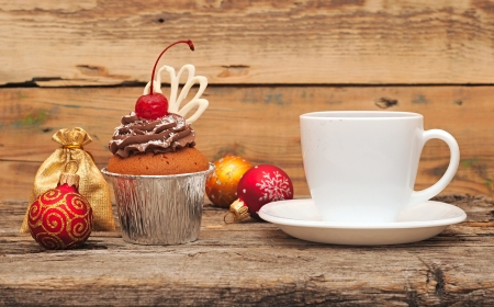 Chocolate cherry cupcakes on old wooden background. Christmas breakfast photo