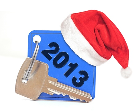 New Year 2013 date, red Santa cap on blue label with metal key Stock Photo - 16459382