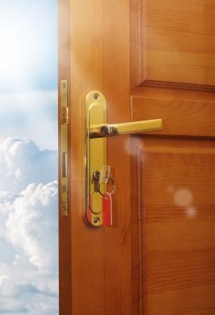 opened door with sky Stock Photo