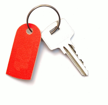 Blank tag and a key isolated on white background photo