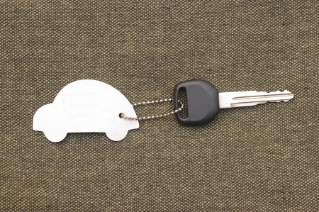 Keys to the car with trinkets in the form of a car. Stock Photo - 16542221
