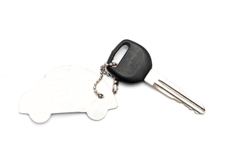 trinkets: Keys to the car with trinkets in the form of a car. Stock Photo
