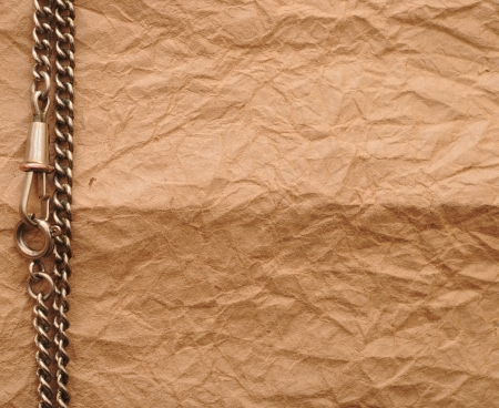 old paper and silver chain with copy space Stock Photo - 16542099