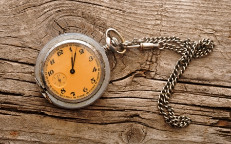 vintage pocket watch on wood board photo