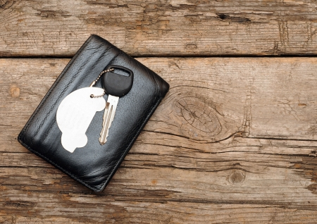 car keys and documents on dark wooden background  photo