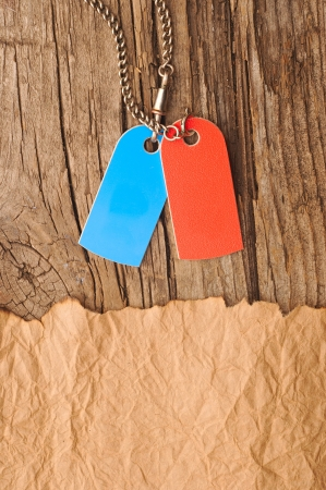 blank tags blue and red with silver chain on vintage background photo