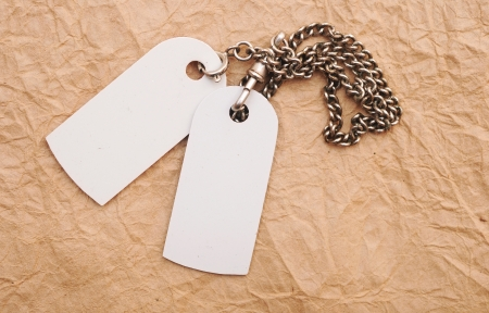 blank tags with silver chain on vintage paper  photo