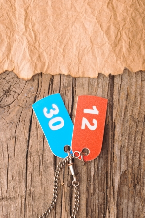 two colorful tags with numbers on old paper  photo