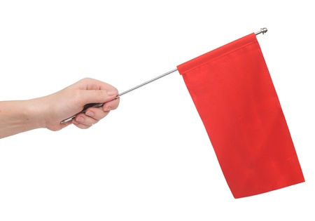 Hand holding a red flag isolated on white background. Put your own text photo