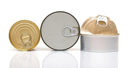 reprocess: Assortment of food tin can reflected on white background