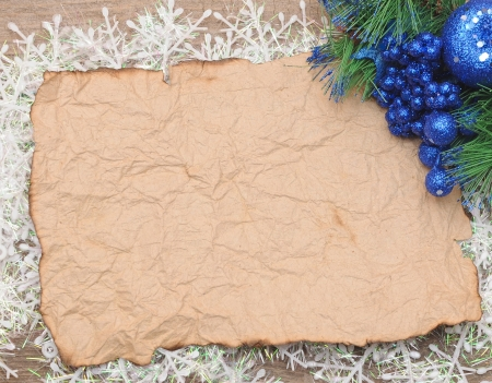 Christmas background. blank old paper sheet and christmas decorations photo