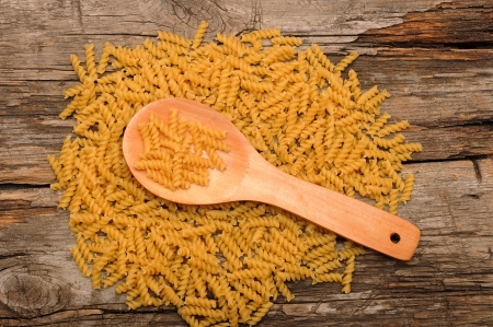 background of pasta and a wooden spoon photo
