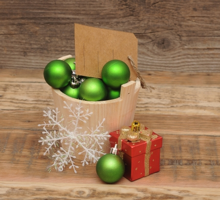 Christmas decoration with blank price tag on wooden plank photo