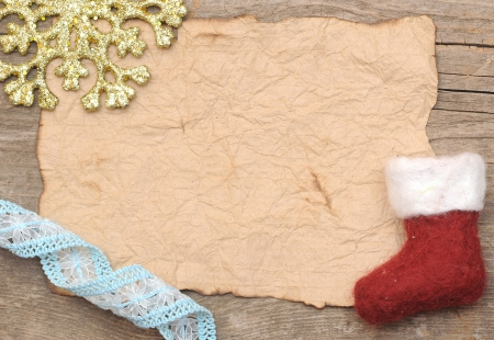 Christmas decoration and vintage paper on the wood background  photo