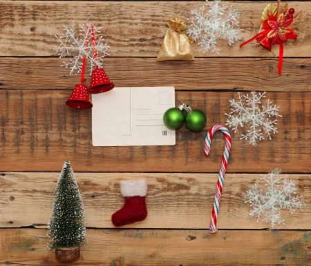 Christmas decoration and vintage postcad on the wood background photo