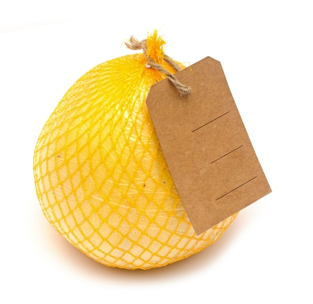 Pomelo fruit with blank price tag wrapped in a plastic photo