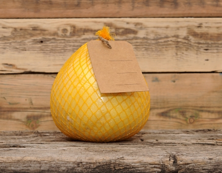 Pomelo fruit with blank price tag wrapped in a plastic Stock Photo - 16801848