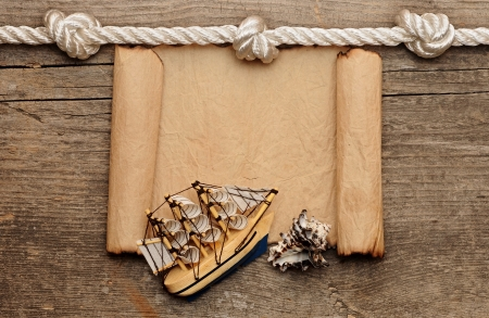 rope and model classic boat on wood background Stock Photo - 16945531