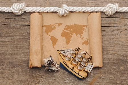 old crumpled world map on wooden background photo