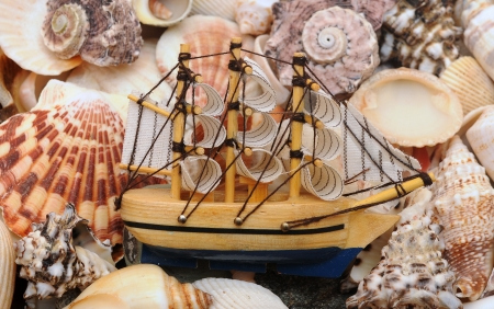 model classic boat on sea shells background Stock Photo - 16945506