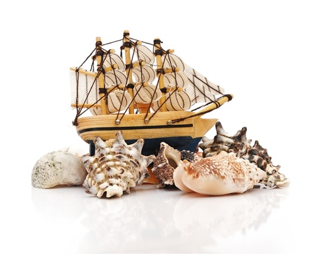 model classic boat on sea shells  Stock Photo - 17023970