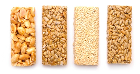 gozinaki: Honey bars with peanuts on white background