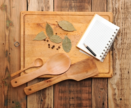 notebook with pencil to write recipes on the background of a cutting board with spices Stock Photo - 17023980