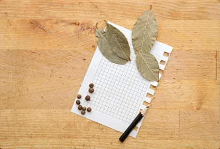 paper for notes and spices on wooden table photo