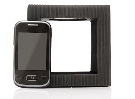 touchline: mobile phone on white. Smart phone on white background with black gift box Stock Photo