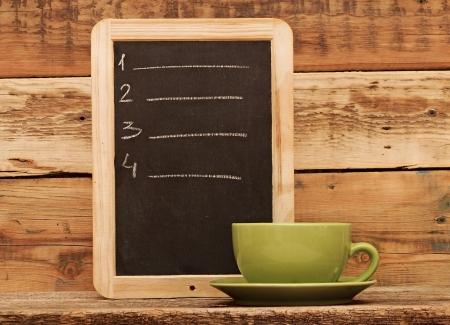 Restaurant chalkboard menu, written in white chalk photo