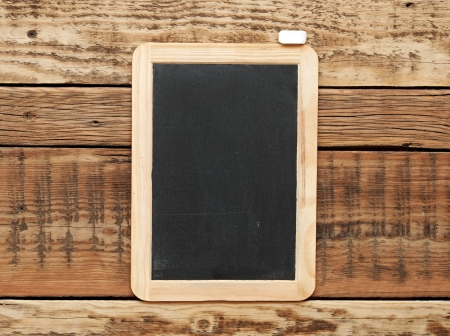 Blackboard on the wood wall. photo