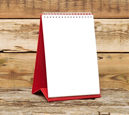 desk calendar on old wooden table Stock Photo