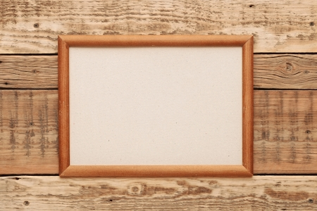 Old picture frame on vintage wood wall. Stock Photo - 17668028