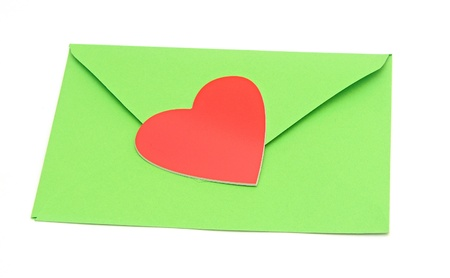 close-up of green paper envelope with red heart  photo