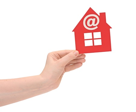 woman hand holding small red plastic house with email icon on white background photo