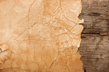Grunge paper on wooden wall background photo