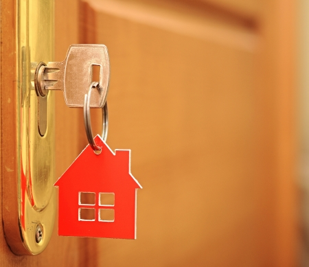 Symbol of the house and stick the key in the keyhole  Stock Photo